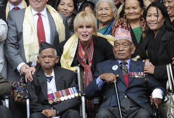 British actress Joanna Lumley poses with former Gurkha soldiers outside the High Court in London