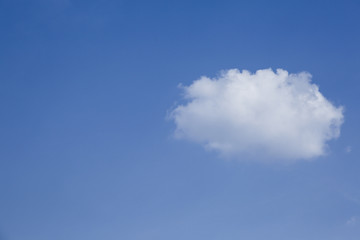 One cloud on blue sky background