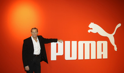Zeitz, CEO of German sports goods firm Puma poses for photographers before the company's annual news conference in Nuremberg