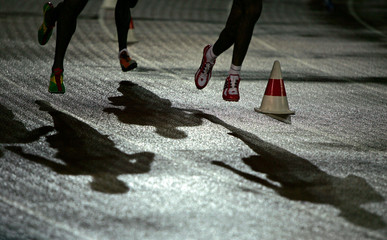 Competitors run during the men's 10,000 metres final at the world athletics championships in Helsinki.