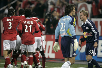 New York Red Bulls defender Chris Leitch walks by his goalkeeper Ronald Waterreus after Leitch gets an own goal as the Toronto FC celebrate during their MLS soccer match in Toronto