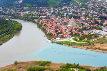 Panoramic aerial view of Mtskheta, Georgia with rivers Mtkvari or Kura and Aragvi, Svetitskhoveli Cathedral