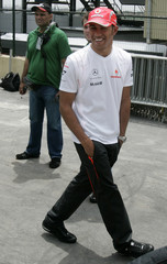 McLaren's Formula One driver Lewis Hamilton of Britain alks on the pit at Interlagos race track in Sao Paulo