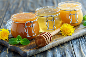 Buckwheat, linden and flower honey in glass jars.