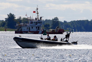 Security forces patrol the Ottawa River around the Chateau Montebello hotel in Montebello