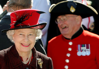 Britain's Queen Elizabeth II smiles during a walkabout on the waterfront at St Helier, Jersey, England.
