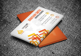 Orange Business Card Layout with Angular Accent Graphics