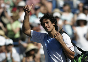 Vassallo Arguello waves after losing to Djokovic at the Indian Wells ATP tennis tournament in Indian Wells