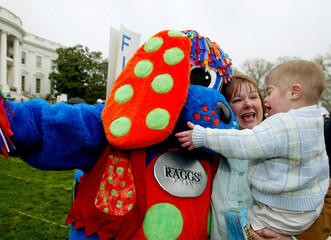 CARTOON CHARACTER MEETS CHILD AT EASTER EGG ROLL AT WHITE HOUSE.