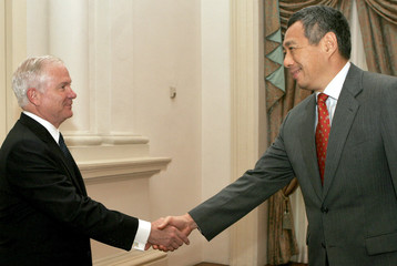 U.S. Secretary of Defense Gates shakes hands with Singapore's Prime Minister Lee in Singapore