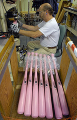 Hillerich & Bradsby's employee Danny Forrest foil stamps the Louisville Slugger and Breast Cancer logos on pink baseball bats for St. Louis Cardinals' David Eckstein at it's Louisville Slugger plant in Louisville