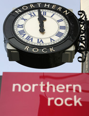 File photograph shows a clock outside a Northern Rock branch in Newcastle, northern England