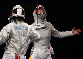 Germany's Limbach reacts as she competes with Ukraine's Khomrova in the women's individual sabre round of 16 fencing event at the World Fencing Championship in Antalya
