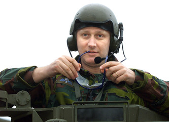 Belgian Crown Prince Philippe looks out from a Pandur armoured vehicle  in Diest February 20, 2002. ..