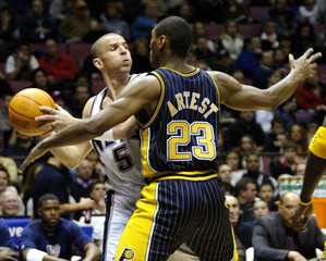 NEW JERSEY NETS KIDD PASSES IN FRONT OF INDIANA PACERS ARTEST.