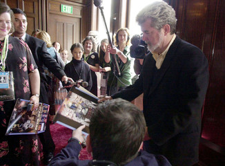 DIRECTOR GEORGE LUCAS SIGNS AUTOGRAPH BEFORE STAR WARS PREMIERE IN SANFRANCISCO.