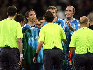 Club Bruges players confront referee after losing to Besiktas in UEFA Cup match in Istanbul