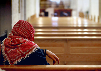A Christian Palestinian attends mass in the empty Church of the Nativity in the West Bank City of Be..