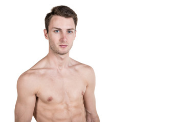 Healthy lifestyle and fitness. Handsome guy sports physique, with a naked body, on the left side of the frame, isolated on a white background. Horizontal frame