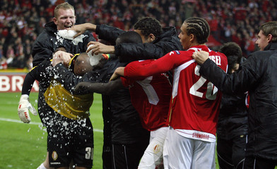 Standard Liege's goalkeeper Bolat celebrates with teammates after scoring a goal during their Champions League soccer match against AZ Alkmaar at Sclessin stadium in Liege