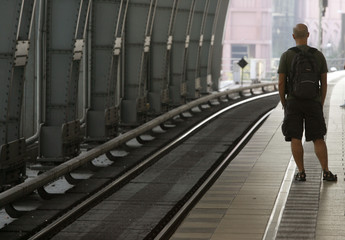 A passenger waits for a local train during a warning strike at Berlin's Alexanderplatz station