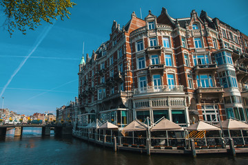 Canal at Amsterdam Central, Netherlands.
