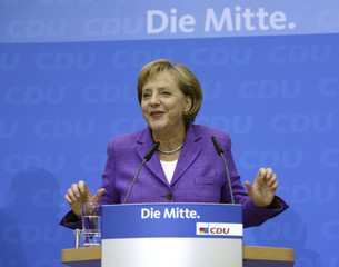 German Chancellor Merkel arrives for a news conference at CDU party headquarters in Berlin
