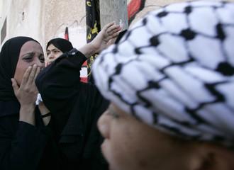 Palestinian relatives of a senior Islamic Jihad commander al-Harazeen mourn during his funeral in Gaza