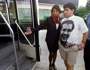 Argentine soccer star Diego Armando Maradona, wearing a T-shirt with the icon of Latin American guer..