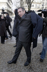 France's UDF centre-right political party leader Francois Bayrou puts on his coat as he campaigns in Bordeaux