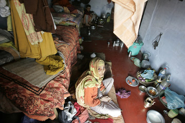 A Nepali woman rests inside a widows home in Varanasi