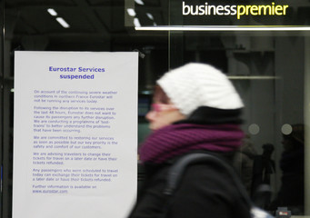 A passenger passes a cancellation notice  after the Eurostar train service was cancelled at St Pancras Station in London