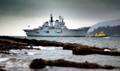 British aircraft carrier HMS Ark Royal sails up Loch Long in Scotland, January 13, 2003. [The flagsh..