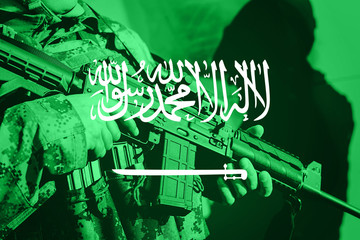 Soldier with machine gun with national flag of Saudi Arabia