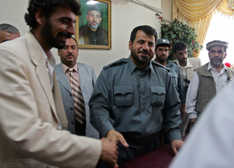 Kabul's new police chief General Gozar greets people at his office in Kabul