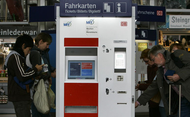 Travelers buy tickets at Munich's train station
