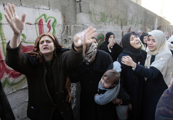 Palestinians mourn during the funeral for Palestinians killed at a U.N school, in Jabalya in the northern Gaza Strip