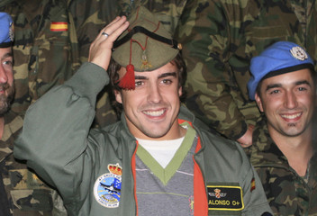 Spain's Formula One champion Alonso puts on military cap during his visit to the Spanish U.N. peacekeeping Cervantes Battalion in Blat village in south Lebanon