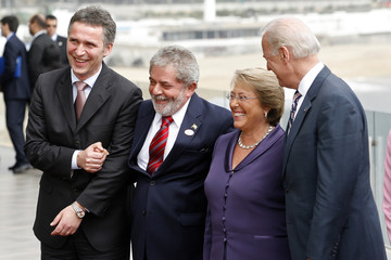 Norway's PM Stoltenberg, Brazil's President Lula da Silva, Chile´s President Bachelet and U.S. VP Biden pose for a group photo during a break in the Progressive Leaders' Summit in Vina del Mar