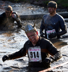 An athlete reacts to the cold water during the Tough Guy event in Perton