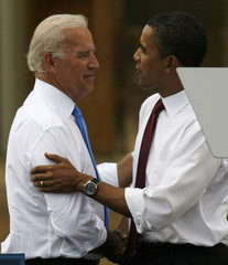 US Democratic presidential candidate Obama greets his vice presidential running mate Biden at campaign event at Old State Capitol in Springfield