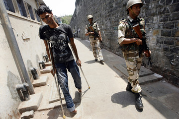 Paramilitary troops patrol a residential area next to Arthur Road jail in Mumbai