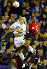 LEEDS UNITED'S SMITH JUMPS FOR THE BALL WITH MANCHESTER UNITED'SFORTUNE DURING THEIR SOCCER MATCH AT ...