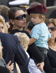 Wife of slain Italian army Sergeant Major Valente holds her son during arrival ceremony of coffins at Ciampino airport in Rome