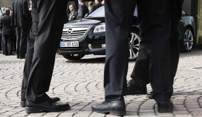 Opel traders gather around a Opel Insignia during a break of a general meeting of German Opel Traders association (VDOH) in Darmstadt