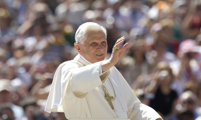 Pope Benedict XVI waves as he arrives to lead his general audience in Saint Peter's Square at the Vatican
