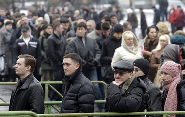 People line up to attend a job fair in St Petersburg