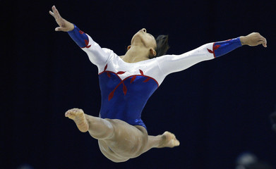 Downie of Britain performs on the beam during the World Gymnastic Championships in London