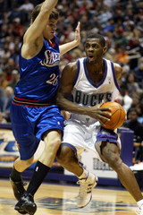 Milwaukee Bucks forward Desmond Mason is fouled by Philadelphia 76ers forward Kyle Korver.