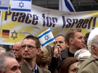 PROTESTERS TAKE PART IN A PRO ISRAELI DEMONSTRATION IN BERLIN.